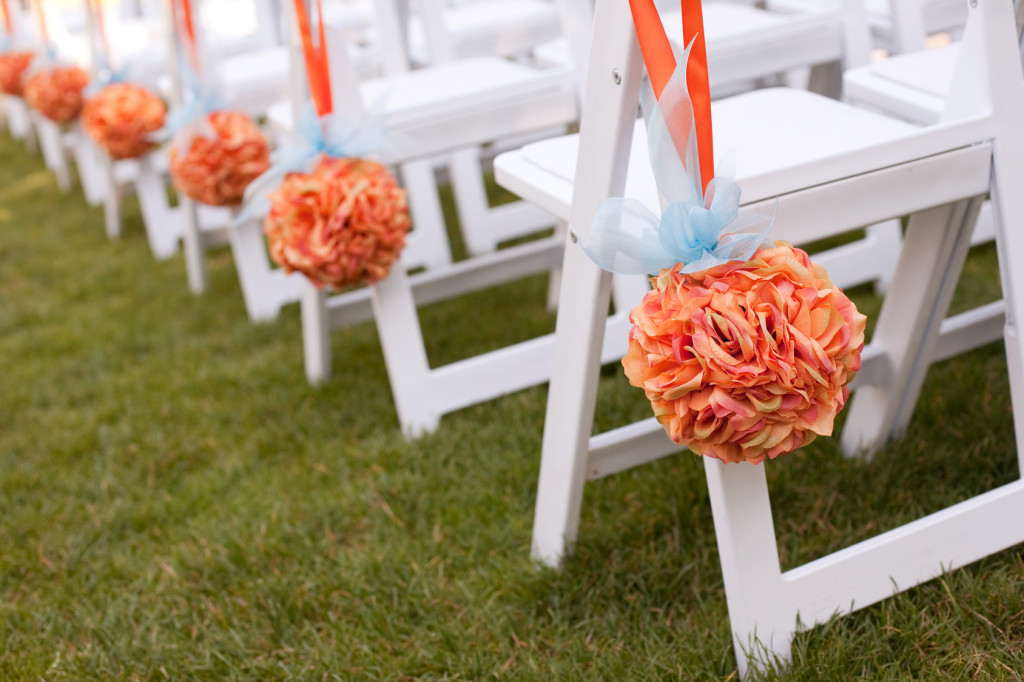 Beautiful orange Wedding Flower Arrangements Along the Aisle